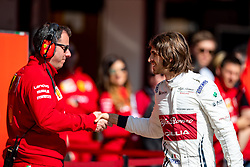 February 28, 2019 - Montmelo, Barcelona, Calatonia, Spain - Antonio Giovinazzi of Alfa Romeo Racing seen shaking hands with Ferrari's team mate during the second week F1 Test Days in Montmelo circuit, Catalonia, Spain. (Credit Image: © Javier Martinez De La Puente/SOPA Images via ZUMA Wire)