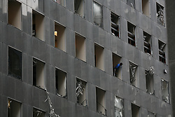 Stock photo of an office building's windows in downtown Houston blown out by winds from Hurricane Ike