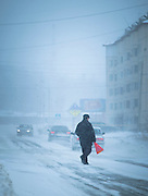 Pedestrians walking from Severobaikal Train Station. Siberia, Russia