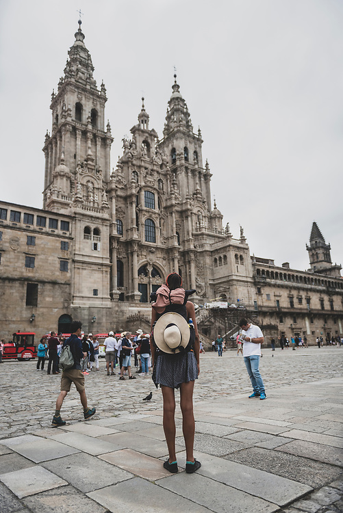 Alice, from England, faces the cathedral in Praza do Obradoiro, the main square in Santiago de Compostela and the end point for most people's pilgrimage. (July 12, 2018)<br /> <br /> DAY 46: STAYED IN SANTIAGO DE COMPOSTELA