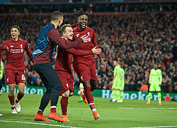BRITAIN-LIVERPOOL-FOOTBALL-UEFA CHAMPIONS LEAGUE-LIVERPOOL VS FC BARCELONA..(190507) -- LIVERPOOL, May 7, 2019  Liverpool's Divock Origi (R) celebrate after scoring during the UEFA Champions League Semi-Final second Leg match between Liverpool FC and FC Barcelona at Anfield in Liverpool, Britain on May 7, 2019. Liverpool won 4-3 on aggregate and reached the final. FOR EDITORIAL USE ONLY. NOT FOR SALE FOR MARKETING OR ADVERTISING CAMPAIGNS. NO USE WITH UNAUTHORIZED AUDIO, VIDEO, DATA, FIXTURE LISTS, CLUBLEAGUE LOGOS OR ''LIVE'' SERVICES. ONLINE IN-MATCH USE LIMITED TO 45 IMAGES, NO VIDEO EMULATION. NO USE IN BETTING, GAMES OR SINGLE CLUBLEAGUEPLAYER PUBLICATIONS. (Credit Image: © Xinhua via ZUMA Wire)