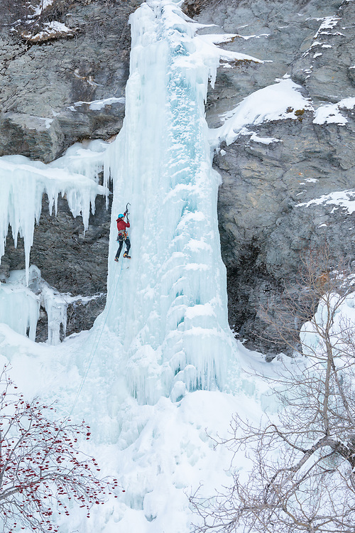 Nathalie Fortin climbing La Cigarette Bleu, Wi4+ in Gaspesie Quebec