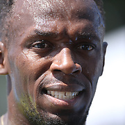 Usain Bolt, Jamaica, with wet sweat dripping from him in the heat after his win in the Men's 200m during the Diamond League Adidas Grand Prix at Icahn Stadium, Randall's Island, Manhattan, New York, USA. 13th June 2015. Photo Tim Clayton