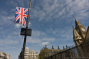 A Union Jack flag flies on a street light pole in Parliament Square, days before the royal wedding ceremony of Prince William and Kate Middleton. To the right we see the tower containing the bell of Big Ben, the seat of British government and democracy and the spring weather brings blue skies to the capital as the nation prepares to celebrate the state occasion.