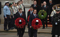 (c) London News Pictures. 14/11/2010.  Prime Minister David Cameron leads Deputy Prime Minister Nick Clegg and other ministers out in front of the Cenotaph today (Sun). The Queen today (Sun) led the Remembrance Sunday service at the Cenotaph in London in honour of those who have died in wars and conflicts. Picture credit should read: Will Oliver/London News Pictures