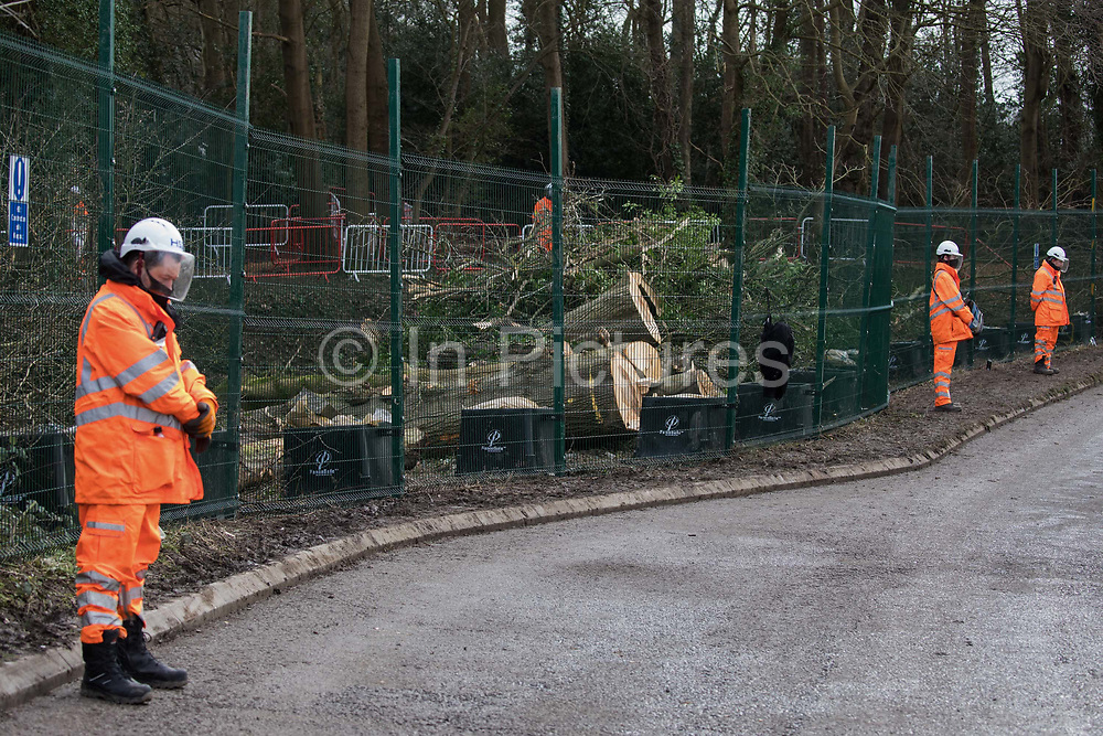 HS2 security workers guard an area of woodland alongside Small Dean Lane currently being cleared for the high-speed rail link on 20th February 2021 in Wendover, United Kingdom. Anti-HS2 activists based at the nearby Wendover Active Resistance Camp continue to oppose the felling of the woodland.