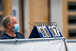 Floor volunteers sit with mouth and nose masks along the line during the supercup final between Amysoft Lycurgus - Active Living Orion on October 04, 2020 in Van der Knaaphal, Ede