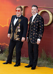 Elton John and David Furnish attend the London premiere of The Lion King.<br />