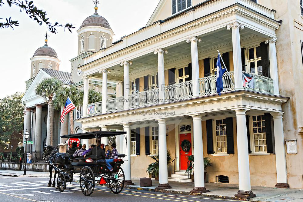 Horse carriage tour along historic Meeting Street in Charleston, South Carolina.