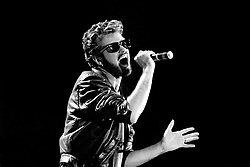 File photo dated 13/07/85 of George Michael of Wham performing at the Live Aid concert at Wembley Stadium in London, as the pop superstar has died peacefully at home, his publicist said.