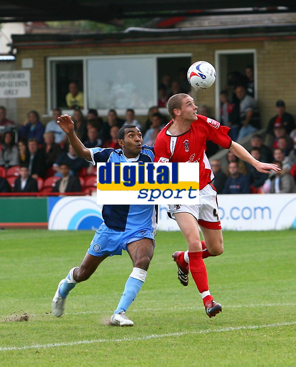 Photo: Andrew Unwin.<br />Accrington Stanley v Wycombe Wanderers. Coca Cola League 2. 30/09/2006.<br />Accrington Stanley's Robert Williams (R) is put under pressure by Wycombe's Kevin Betsy (L).
