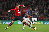 Football - 2018 / 2019 Premier League - Southampton vs. Manchester United<br /> <br /> Marcus Rashford of Manchester United drives past the outstretched leg of Southampton's Jannik Vestergaard at St Mary's Stadium Southampton<br /> <br /> COLORSPORT/SHAUN BOGGUST