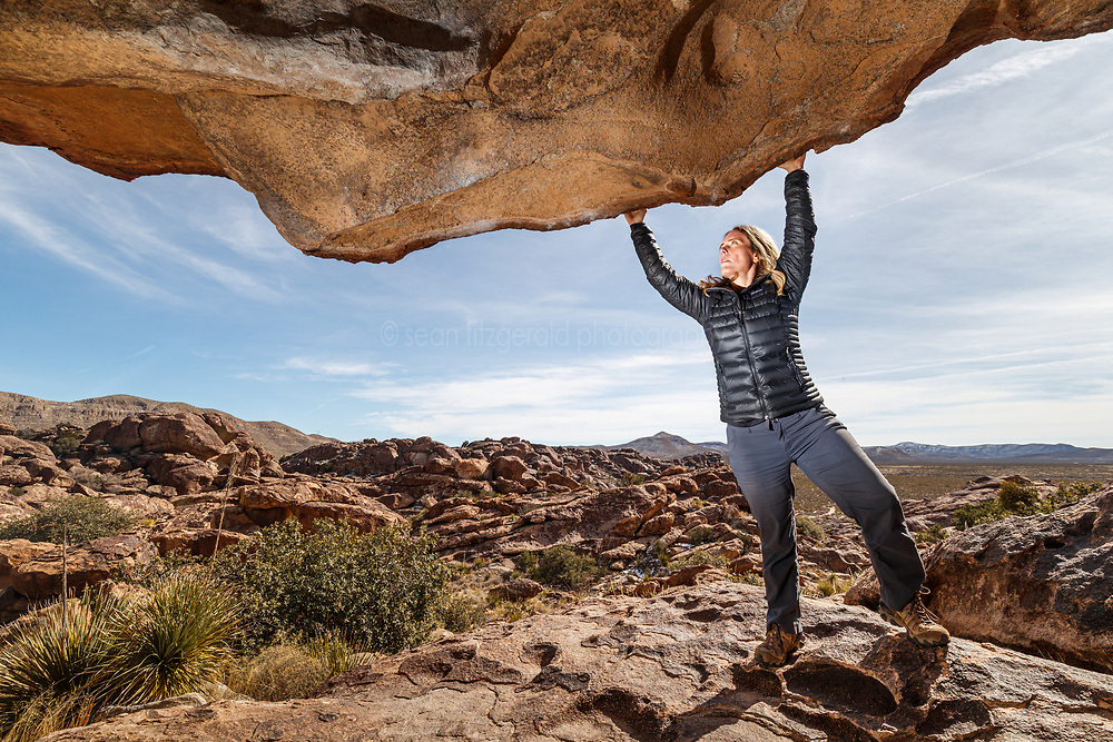 Sarah Hepola on lip of the Moonshine Roof, Hueco Tanks State Park & Historic Site, El Paso, Texas. USA.