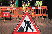 Men at work sign in Birmingham, United Kingdom.