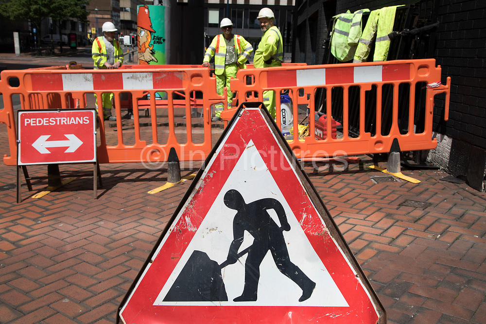Men at work sign in Birmingham, United Kingdom.