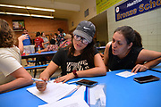 """Volunteers from Keep Tucson Together and attorney Margo Cowan provide legal assistance to persons effected by changes to DACA, or Deferred Action Childhood Arrival, which provided legal protection to those brought into the United States illegally as children, at a clinic at Pueblo Magnet High School, Tucson, Arizona, USA. """"Edna"""", 21, entered the USA on a legal visa at the age of 9, along with her family.  Her father intended to sat in the USA to work. Her family chose to overstay their visas to avoid prolonged separation from her father.  She applied for and was granted DACA status, which lapsed in August, 2017.  With changes to DACA, she faces possible deportation if stopped by law enforcement.  She is a nursing student under the protection of DACA, but may lose that right, as she lost her job when she lost her DACA status.  She is now unemployed.  She initially arrived in the USA with her parents and two siblings.  Her parents then had two US born children.  She attends the clinic to be prepared with legal advice should she be stopped by law enforcement and be slated for deportation to Mexico."""