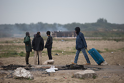 October 24, 2016 - Calais, Calais, France - Calais , France . People leaving the Jungle migrant camp in Calais , Northern France , with their parents , on the day of a planned eviction and start of the destruction of the camp  (Credit Image: © Joel Goodman/London News Pictures via ZUMA Wire)