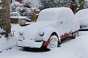 London streets and cars covered in snow after a blizzard in February 2009