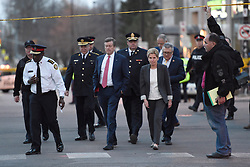 Toronto Police Chief Mark Saunders, front left to right, Toronto Mayor John Tory, Premier Kathleen Wynne and Ralph Goodale, Federal Minister of Public Safety and Emergency Preparedness walk together towards a news conference after viewing the scene where nine people died and 16 others were injured when a van mounted a sidewalk and struck multiple pedestrians Toronto, ON, Canada on Monday, April 23, 2018. Photo by Nathan Denette/CP/ABACAPRESS.COM