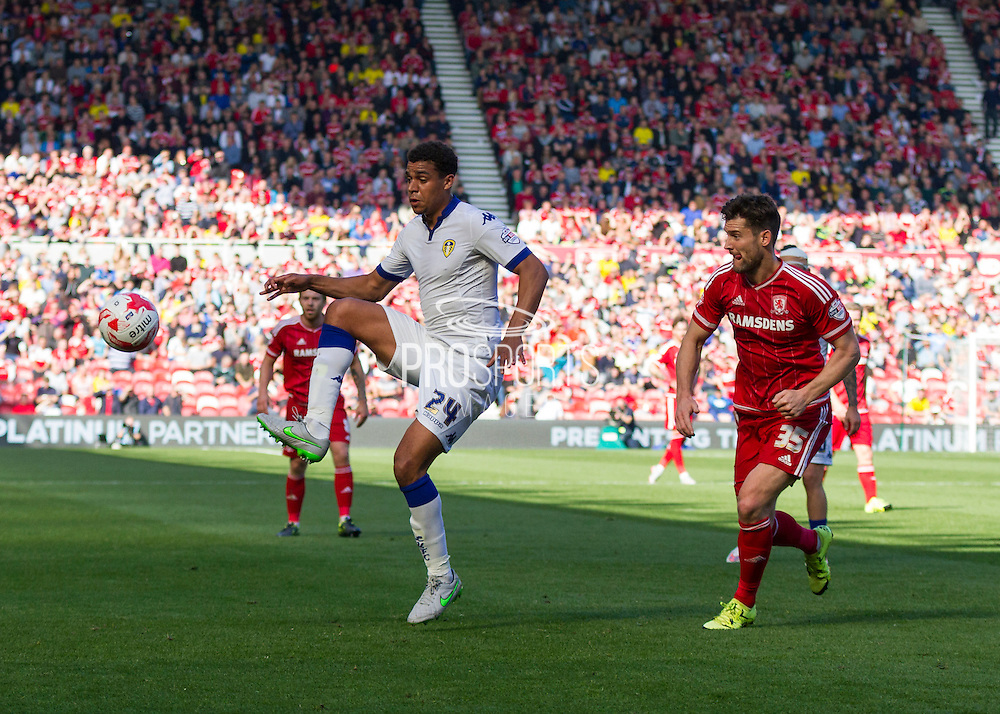 Leeds United FC midfielder Tom Adeyemi  collects the ball shadowed by Middlesbrough FC striker David Nugent during the Sky Bet Championship match between Middlesbrough and Leeds United at the Riverside Stadium, Middlesbrough, England on 27 September 2015. Photo by George Ledger.