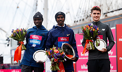 Mo Farah (centre) winner of the Vitality Big Half alongside second placed Daniel Wanjiru, (left) and third placed Callum Hawkins, (right) during the Vitality Big Half in London City Centre.