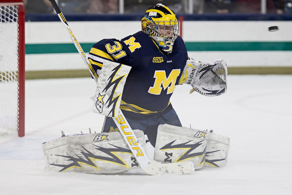 Michigan goaltender Shawn Hunwick (#31) makes save in second period action of NCAA hockey game between Notre Dame and Michigan.  The Michigan Wolverines defeated the Notre Dame Fighting Irish 2-1 in game at the Compton Family Ice Arena in South Bend, Indiana.