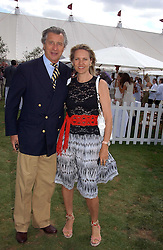 ARNAUD BAMBERGER and his wife CARLA at the Cartier International polo at Guards Polo Club, Windsor Great Park, on 30th July 2006.<br /><br />NON EXCLUSIVE - WORLD RIGHTS