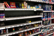 Empty supermarket shelves due to panic buying of essential goods during the coronavirus outbreak on 7th March 2020 in London, United Kingdom. Some customers have started shopping in bulk for certain items to stockpile as the virus continues to spread and the number of cases increases, amid concerns for public health. Here, pain killers like paracetamol and ibuprofen have been cleared from the healthcare shelf.