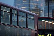 A bus passenger naps on the top deck while queueing on London Bridge during the evening rush-hour, on 7th November 2018, in London, England.