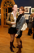 Chloe Delavigne and India Standing, Hip Art, in aid of Stowe House Preservation Trust and friends of War Memorials. Christie's. 16 March 2004. ONE TIME USE ONLY - DO NOT ARCHIVE  © Copyright Photograph by Dafydd Jones 66 Stockwell Park Rd. London SW9 0DA Tel 020 7733 0108 www.dafjones.com
