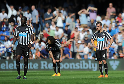 Newcastle United's Moussa Sissoko, Newcastle United's Fabricio Coloccini and Newcastle United's Ryan Taylor cut dejected figures - Photo mandatory by-line: Dougie Allward/JMP - Mobile: 07966 386802 - 16/05/2015 - SPORT - football - London - Loftus Road - QPR v Newcastle United - Barclays Premier League