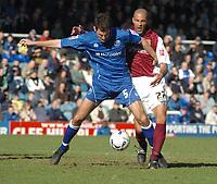 Photo: Ian Hebden.<br />Peterborough United v Northampton Town. Coca Cola League 2. 01/04/2006.<br />Peterboroughs Phil Bolland (L) fends of Northamptons Jason Lee (R).