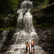 Children play at the base of Cathedral Falls along US Highway 60 in Gauley Bridge, West Virginia. Nathan Lambrecht/Journal Communications