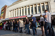 Crowds gather outside Hammersmith Apollo for the Peoples Assembly Stand Up Against Austerity comedy gig. London.