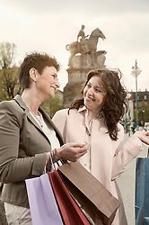 Two mature women shopping in the city, Bavaria, Germany