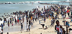 Cape Town-181007-Scores of Khayelitsha residents flocked to the Monwabisi beach as temperatures rise to 32 degrees i the Mother City.kids also enjoyed their last day of spring school holiday as they swem at the beach .Photographer:Phando Jikelo/African News Agency(ANA)