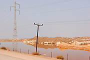 Electric poles inside the Dead Sea water. Experts are warning from an irreversible damage to the Dead Sea because of the rapidly receding of the water level retreating at approximately 15 cm every month.