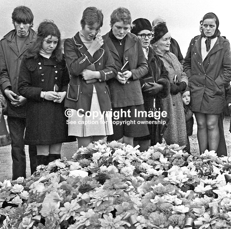 The first anniversary of Bloody Sunday is marked by family and friends of the deceased placing flowers on their graves in the City Cemetry, Londonderry, N Ireland, UK. Bloody Sunday was the name given to the controversial shooting dead of 13 people by the British Army's Parachute Regiment during a Civil Rights March on 30 January 1972. A fourteenth died several months later. 197301280039g<br /> <br /> Copyright Image from Victor Patterson, Belfast, UK<br /> <br /> t: +44 28 9066 1296 (from Rep of Ireland 048 9066 1296)<br /> m: +44 7802 353836<br /> e: victorpattersonbelfast@gmail.com<br /> <br /> www.images4media.com<br /> <br /> Please see my full Terms and Conditions of Use at https://www.images4media.com/p/terms-conditions - it is IMPORTANT that you familiarise yourself with them.<br /> <br /> Images used online incur an additional cost. This cost should be agreed in writing in advance. Online images must be visibly watermarked i.e. © Victor Patterson or that of the named photographer within the body of the image. The original metadata must not be deleted from images used online.<br /> <br /> This image is only available for the use of the download recipient i.e. television station, newspaper, magazine, book publisher, etc, and must not be passed on to a third party. It is also downloaded on condition that each and every usage is notified within 7 days to victorpattersonbelfast@gmail.com.<br /> <br /> The right of Victor Patterson (or the named photographer) to be identified as the author is asserted in accordance with The Copyright Designs And Patents Act (1988). All moral rights are asserted.