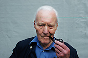 "Tony Benn MP with his trademark pipe on the peace train to Manchester, UK in 2006 with Stop the War Coalition. Anthony Neil Wedgwood ""Tony"" Benn, (3 April 1925 – 14 March 2014), formerly 2nd Viscount Stansgate, was a British Labour Party politician who was a Member of Parliament (MP) for 50 years and a Cabinet Minister."