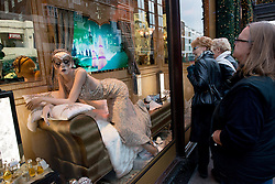 © Licensed to London News Pictures.17/12/2013. London, UK. Shoppers look at festive window display at Harrods department  store only a week before Christmas.Photo credit : Peter Kollanyi/LNP