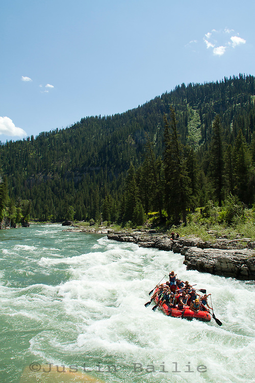 """Rafting through """"Lunch Counter Rapid"""" (class 3) on the Snake River near Jackson,  Wyoming."""