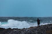 A lady look at the stormy weather, outside Flø, Norway | En dame ser på uværet som herjer på Flø ved Ulsteinvik, Norge.