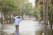 A resident walks through floodwaters to his home in the historic district after record breaking storms dumped more than two feet of rain on the lowcountry October 5, 2015 in Charleston, South Carolina.