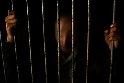 A man arrested for drug use stands in his prison cell in Nogales, Mexico.