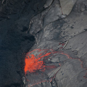 Aerial view of lava flowing from Kiluea Volcano, Hawaii Volcanoes National Park.