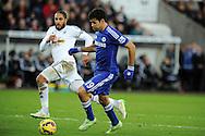 Diego Costa of Chelsea is watched by Ashley Williams of Swansea. Barclays Premier League match, Swansea city v Chelsea at the Liberty Stadium in Swansea, South Wales on Saturday 17th Jan 2015.<br /> pic by Andrew Orchard, Andrew Orchard sports photography.