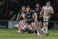 Hallam Amos of the Newport Gwent Dragons breaks free as William Whetton of Brive looks on (R). European Challenge cup pool 3 match, Newport Gwent Dragons v Brive, at Rodney Parade in Newport, South Wales on Friday 14th October 2016.<br /> pic by  Simon Latham, Andrew Orchard sports photography.