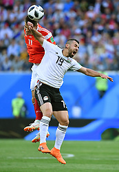 SAINT PETERSBURG, June 19, 2018  Roman Zobnin (L) of Russia competes for a header with Abdalla Said of Egypt during a Group A match between Russia and Egypt at the 2018 FIFA World Cup in Saint Petersburg, Russia, June 19, 2018. (Credit Image: © Li Ga/Xinhua via ZUMA Wire)