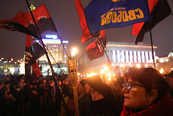 January 1, 2018 - Kyiv, Ukraine - A woman carries a torch as participants of a torchlight procession marking 109 years since the birth of OUN leader Stepan Bandera march through Maidan Nezalezhnosti, Kyiv, capital of Ukraine, January 1, 2018. Ukrinform...KYIV. Members of the public have marked the 109th birthday anniversary of Stepan Bandera, the leader of the Organisation of Ukrainian Nationalists (OUN). Traditionally, they marched along the central streets lighting their way with torches. (Credit Image: © Yevhen Liubimov/Ukrinform via ZUMA Wire)