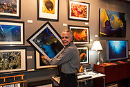"""Photographer Wayne Eastep installing prints for the collection """"The Living Seas"""" at Eastep Photography Gallery.<br /> <br /> The exhibit of images will be on display December 22nd 11 am to 4 pm at 1338 Central Avenue Sarasota, Florida 34236"""